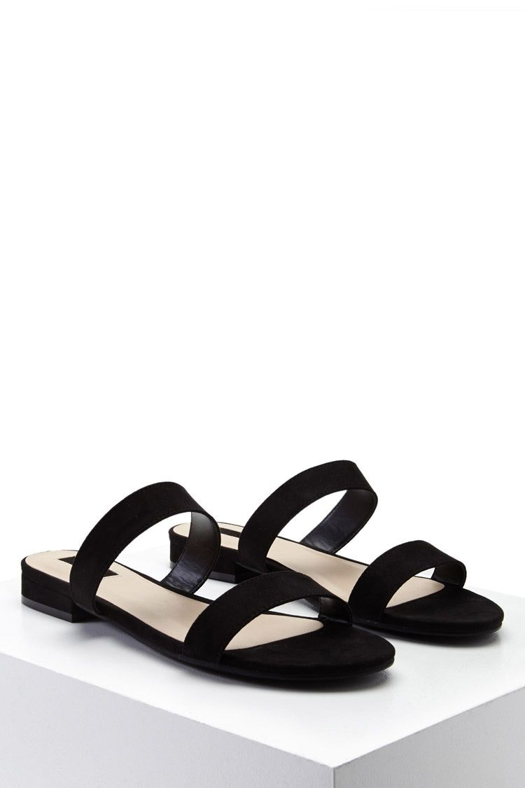 66e30f178 A pair of faux suede sandals featuring an open toe