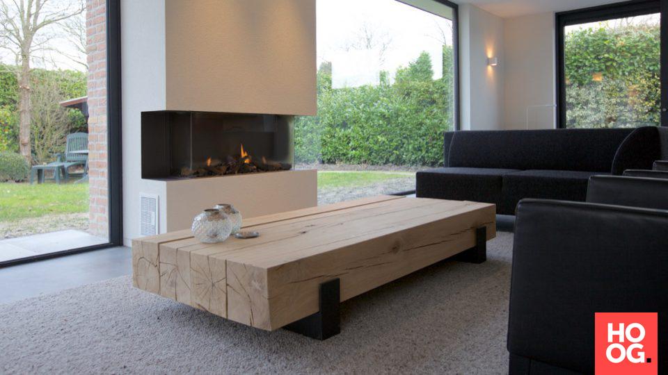 Design meubel in woonkamer inrichting met open haard | woonkamer ...