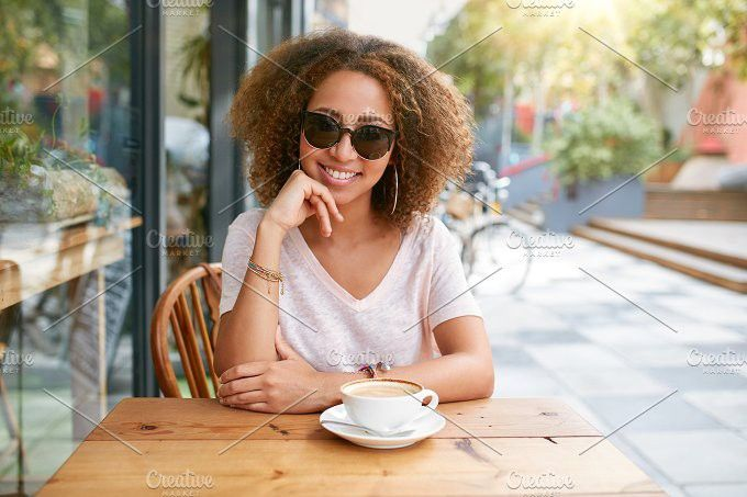 Attractive woman at an outdoor cafe. People Photos