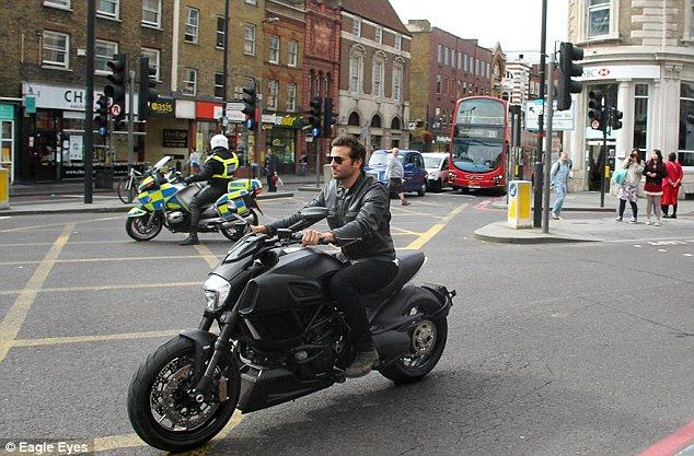 Bradley Cooper rides a ducati motorcycle on the streets of London. via MailOnline