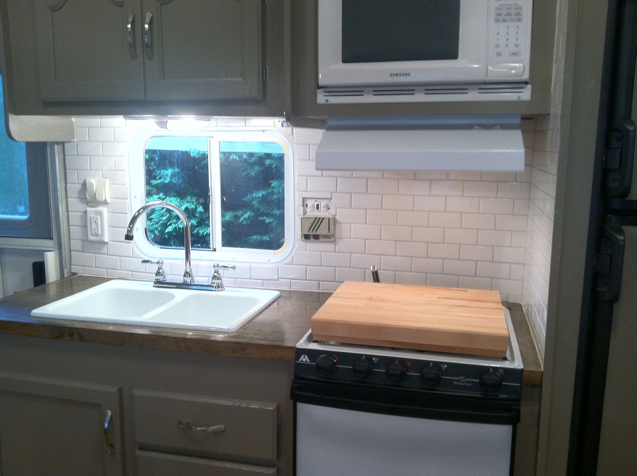 Camper Reno Added Small White Subway Tile On Backsplash And