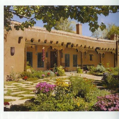 adobe house with porch like the old world spanish style of this
