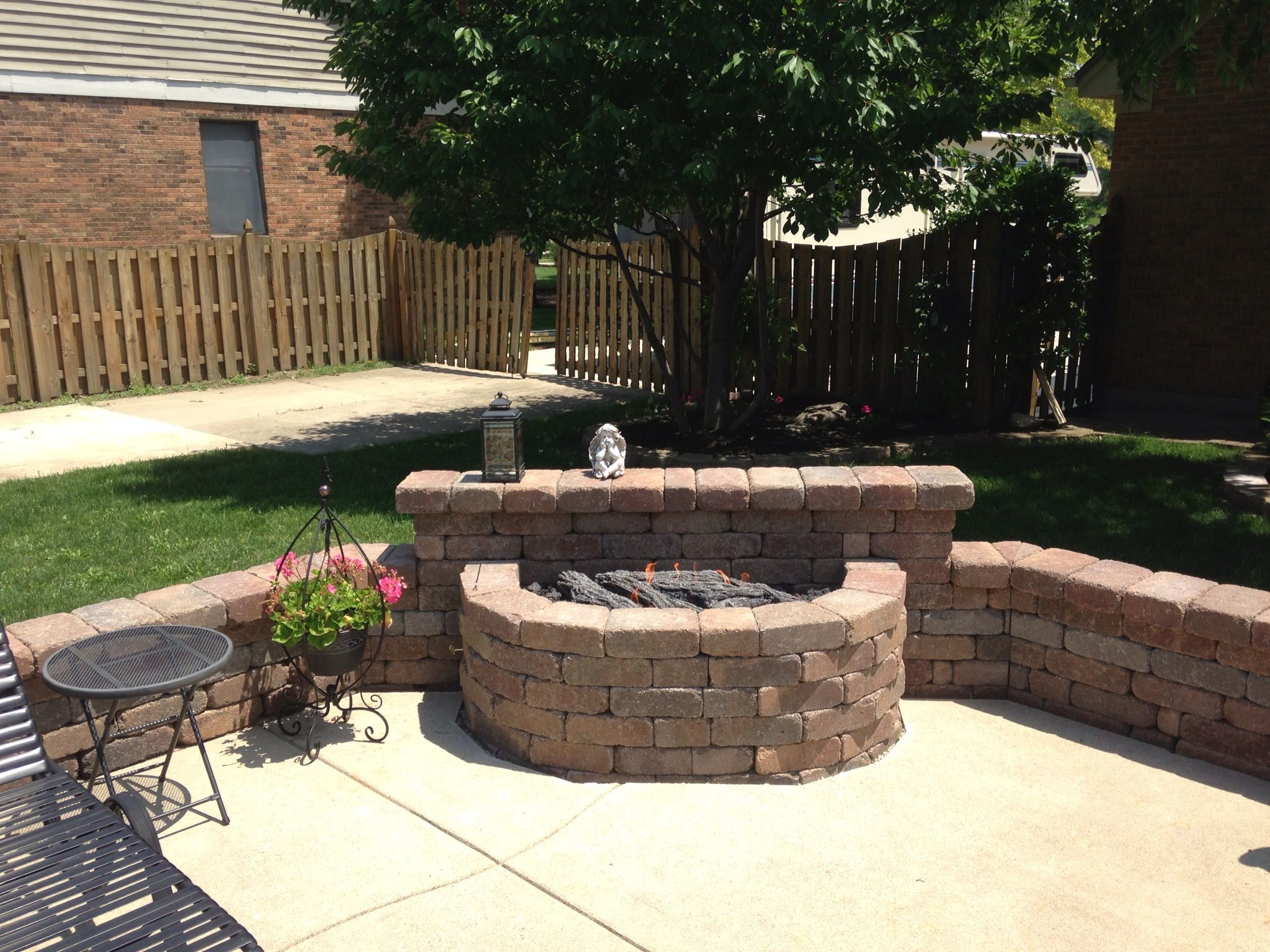 Natural gas fire pit installed in seat wall around pool fire pits