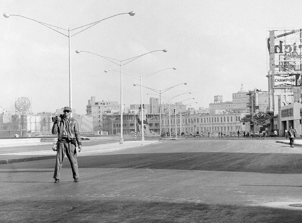 Not a car is visible on Malecon Drive in Havana, Cuba, a street well-known to American tourists in former days, as Fidel Castro's forces take over, using it for defense purposes. A single rifle-toting militiaman walks along the drive in Havana, on January 6, 1961, from which all normal traffic was diverted.