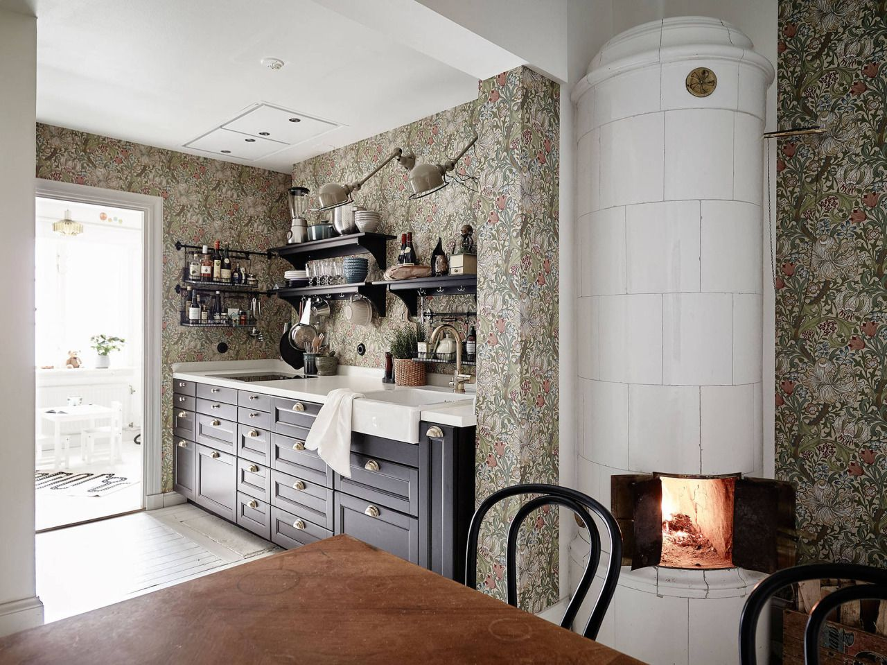 Black kitchen with wallpaper and fireplace kitchen blog pinterest