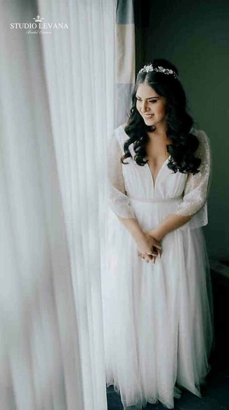 Plus size sparkly ball gown with unique sleeves on a real bride