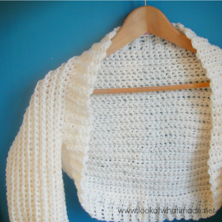 This cream crochet shrug uses only single crochet stitches, worked ...