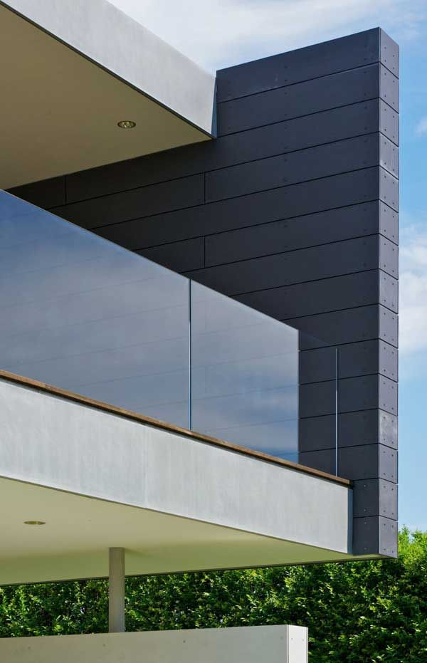 Stunning ocean guest house wrapped in fiber cement panels - Residential exterior glass wall panels ...