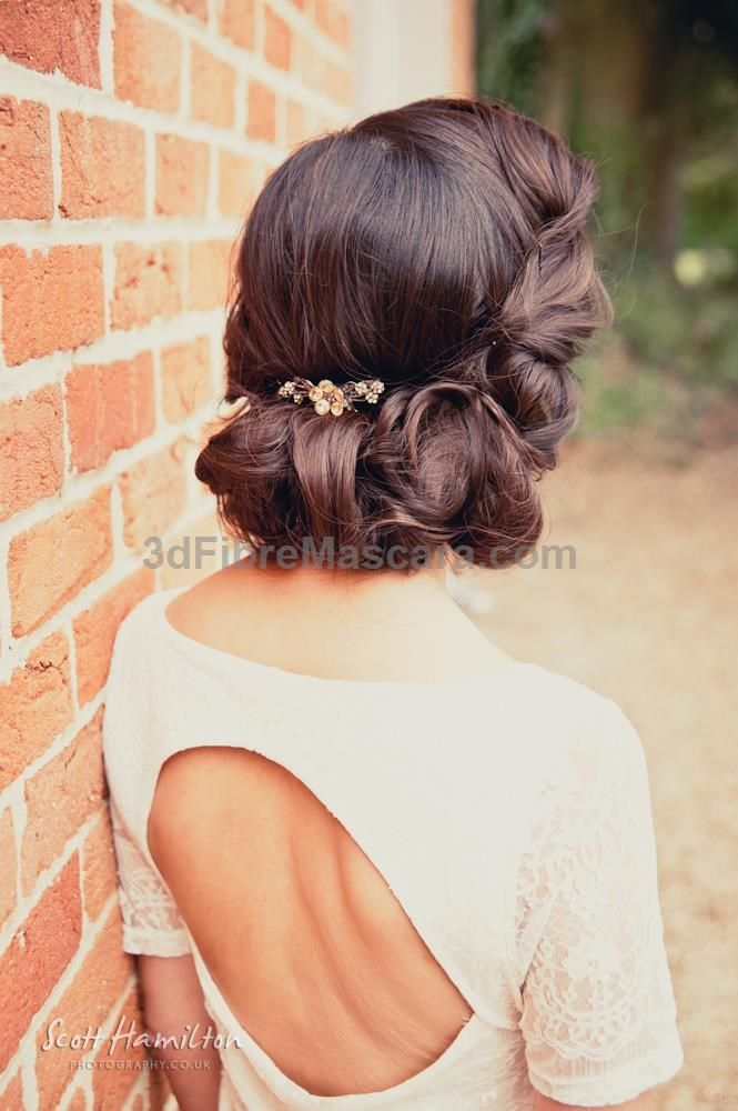 1930s look style up do with small flower detail, wrapped and plaited around the back of the head. Looks absolutely stunning for a vintage bride and wedding.