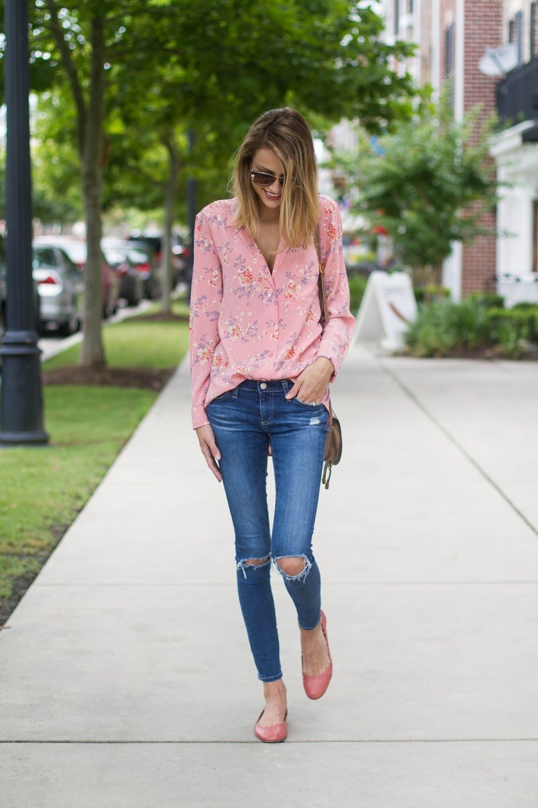pastel pink floral blouse with distressed denim skinny