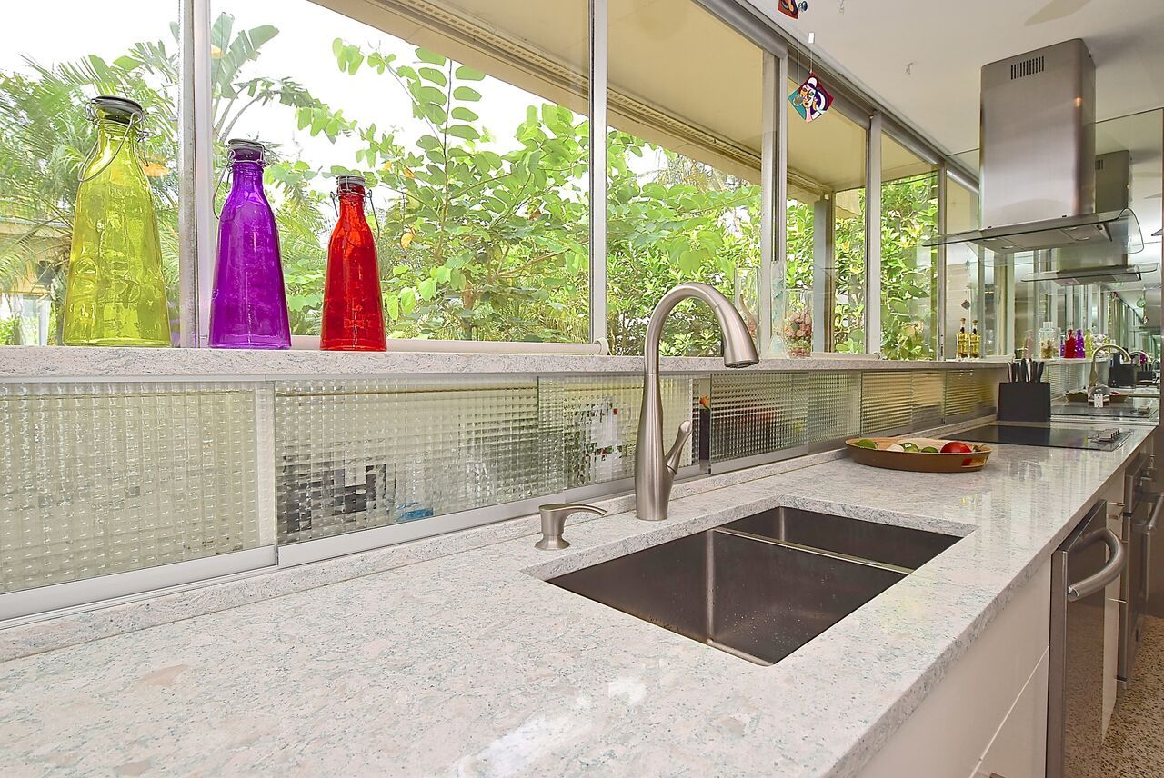 From The Giant Sliding Glass Door To The Terrazzo Floor And Modern Geometric Design This Home Is The Perfe Florida Design Terrazzo Flooring Sliding Glass Door