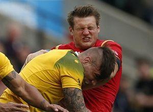 Ooof! Wales' Dan Biggar gets hit by Australia's Sean McMahon.