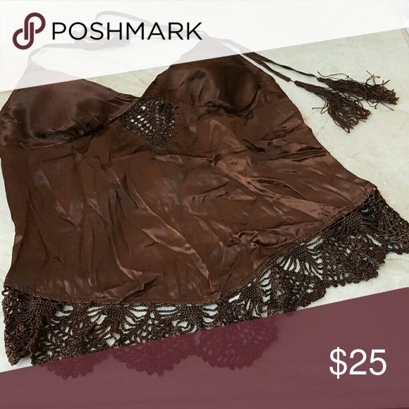 S Guess silk halter tie lace and tassle brown mid Chocolate brown. Gently used.. no flaws except it's wrinkled.  100% silk . It has tassles at the end of the halter tie and the bottom edges have silk lace trim. This top is a mid rif and the back is bare except for the two ribbon ties on the sides that tie from the back. Guess Tops Crop Tops