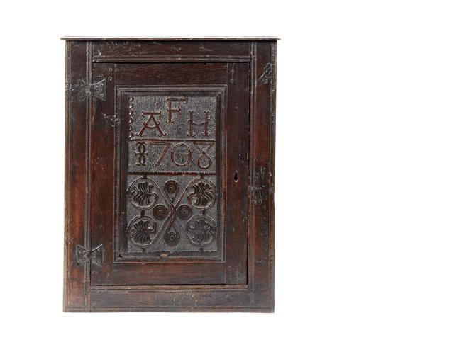 An oak mural cupboard, Westmorland, dated 1708 BONHAMS ...