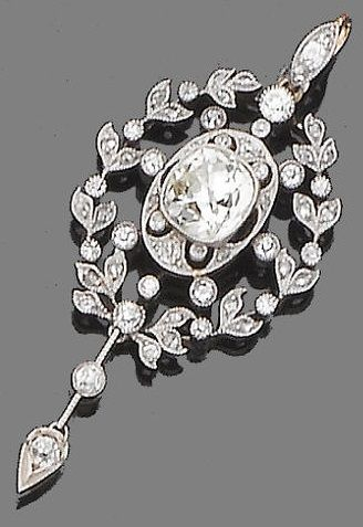 A Belle Epoque diamond pendant, circa 1900. Pierced and millegrain-set, the central cushion-shaped diamond within a single, rose and old brilliant-cut diamond foliate surround, suspending a knife-edge wire and a later old brilliant-cut diamond drop, mounted in silver and gold, principal diamond approx. 2.90ct., length 5.4cm. #BelleÉpoque #pendant