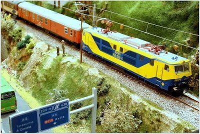 Mantenimiento invernal VIAM (C. de Madrid). Escala H0.  Locomotora eléctrica 250-006-4 RENFE con furgón D12-12404. Escala H0.