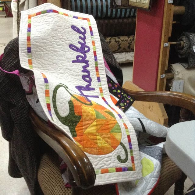 """I really like this quilt, especially the multi-color border and the work """"Thankful"""" in purple.  You could adapt this for any number of holidays / seasons, too.  Valentine's Day could be a large heart and the word """"Love"""", etc."""