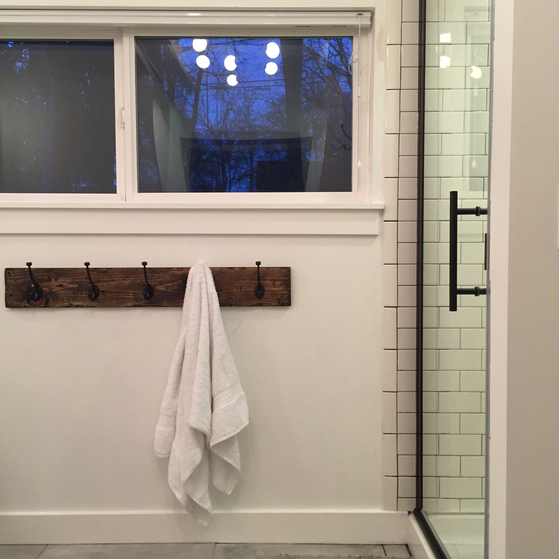 reclaimed wood towel rack oil rubbed bronze shower door clean white walls white