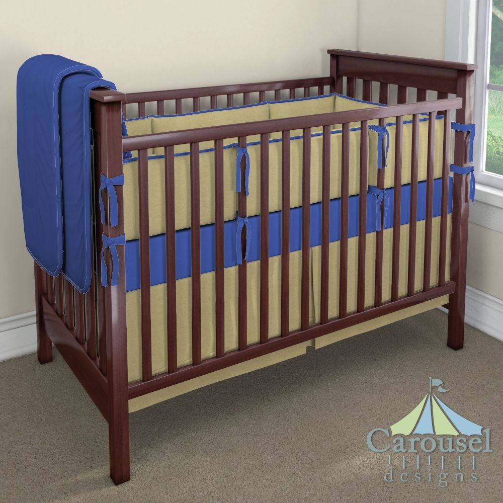 Crib bedding in Solid Royal Blue, Solid Gold Satin. Created using the Nursery Designer® by Carousel Designs where you mix and match from hundreds of fabrics to create your own unique baby bedding. #carouseldesigns
