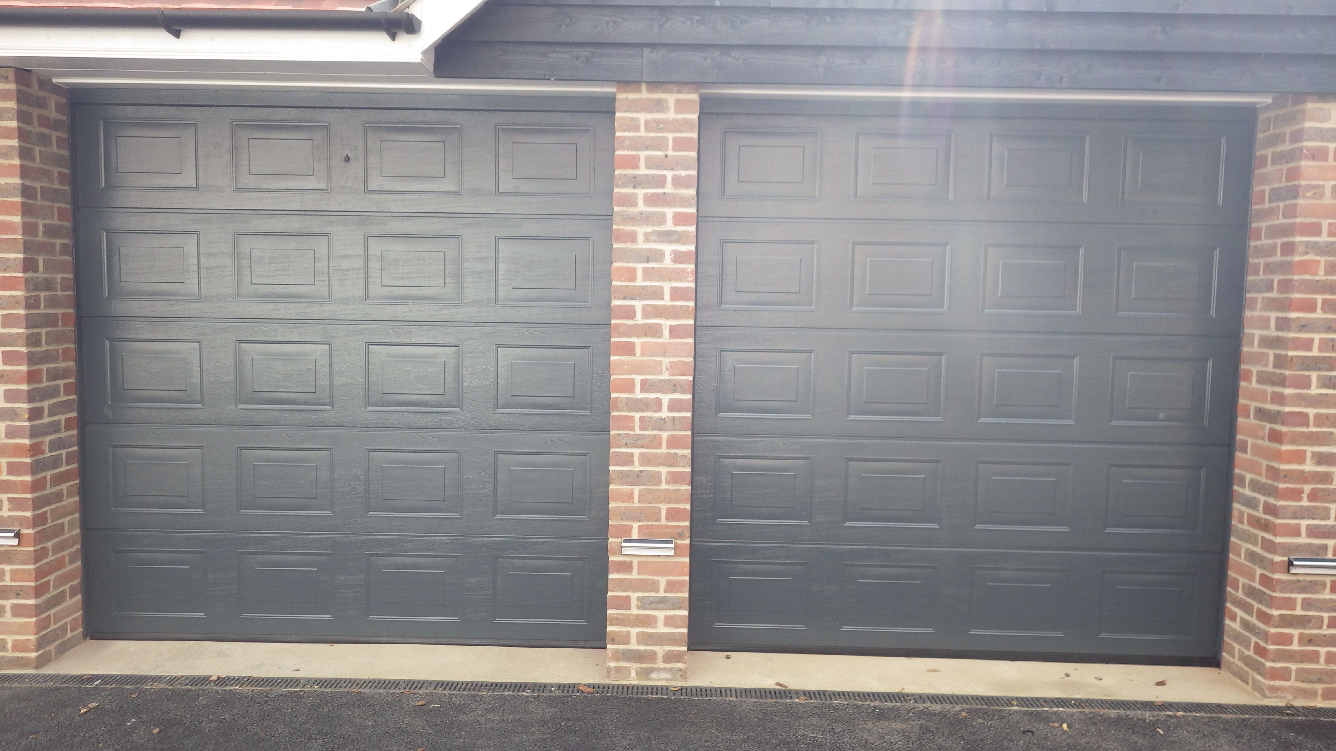 Doors and sidelights matching window on front and black onduline roof - Doors
