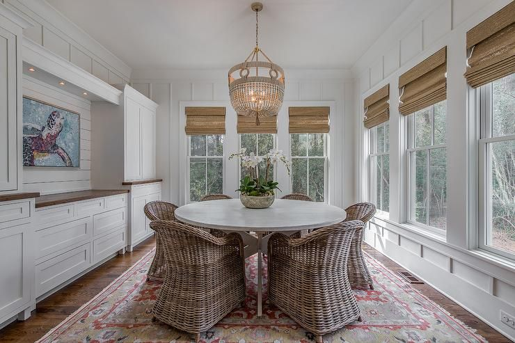 Cottage Style Dining Room With A Built In Sideboard Accented With