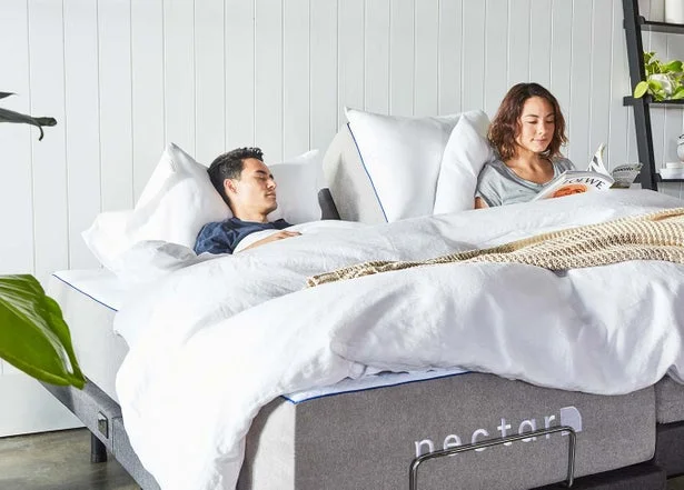 Couple Relaxing On Queen Adjustable Bed Frame Adjustable Bed
