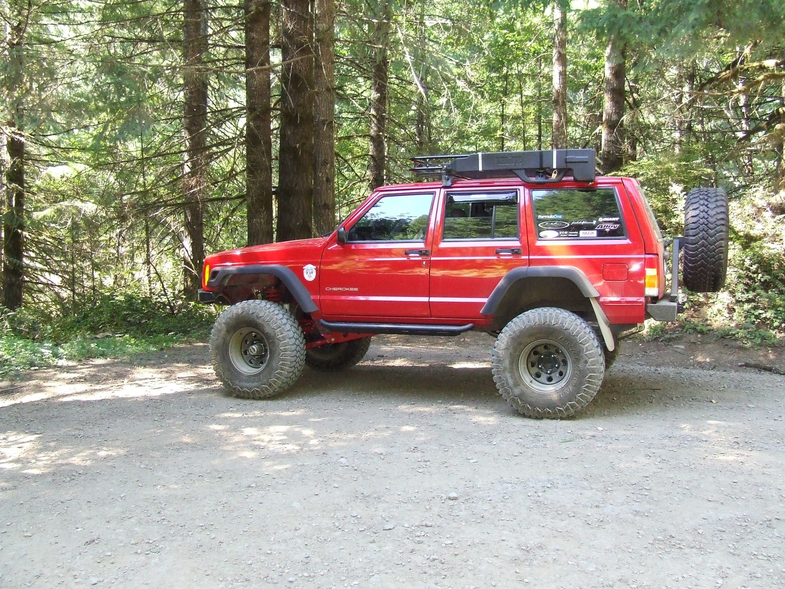 90 S Jeep With Raised Suspension And Red In Color Custom Jeep