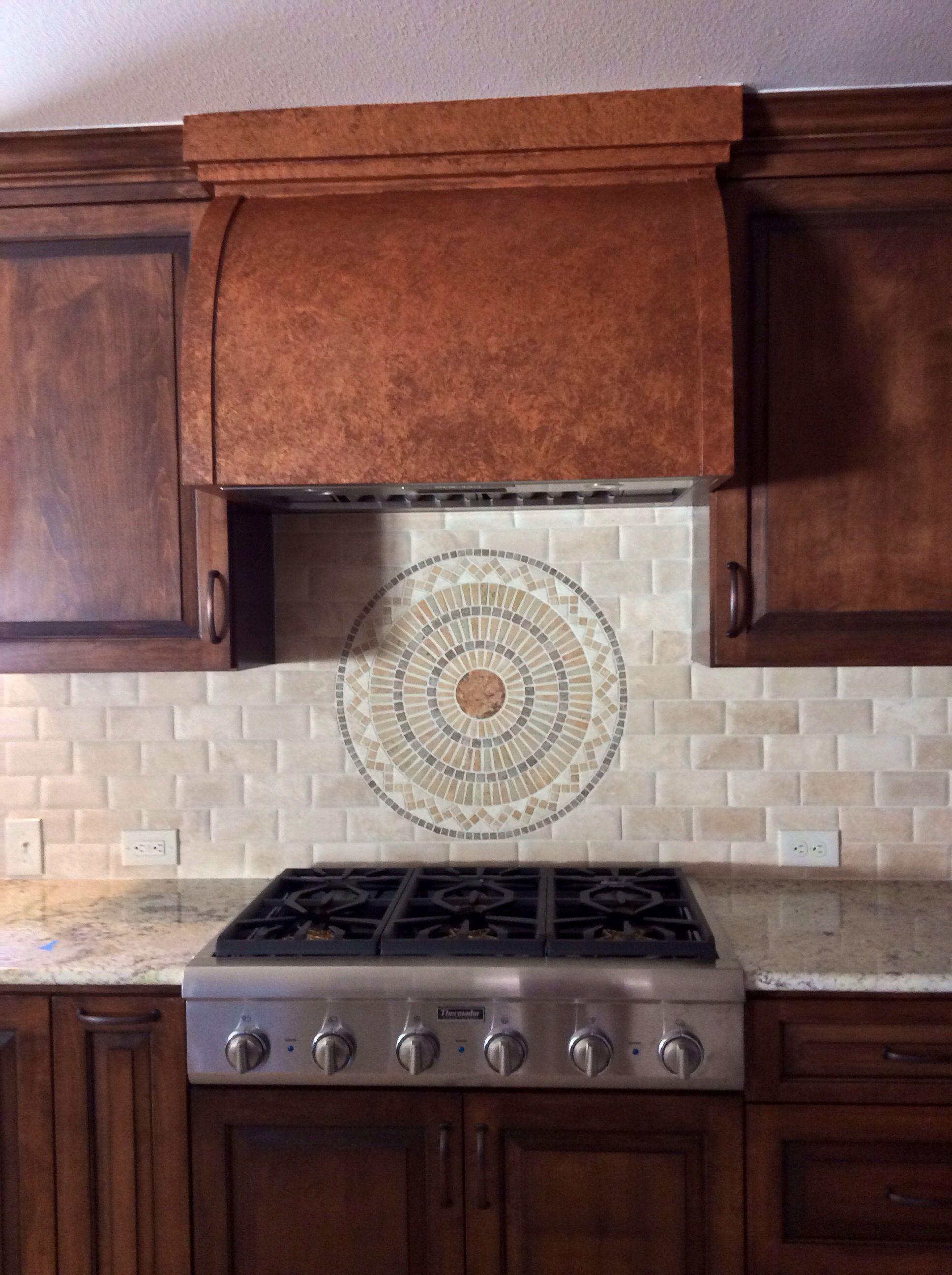 Kitchen Backsplash Centerpiece use a medallion as a centerpiece behind stove | backsplash