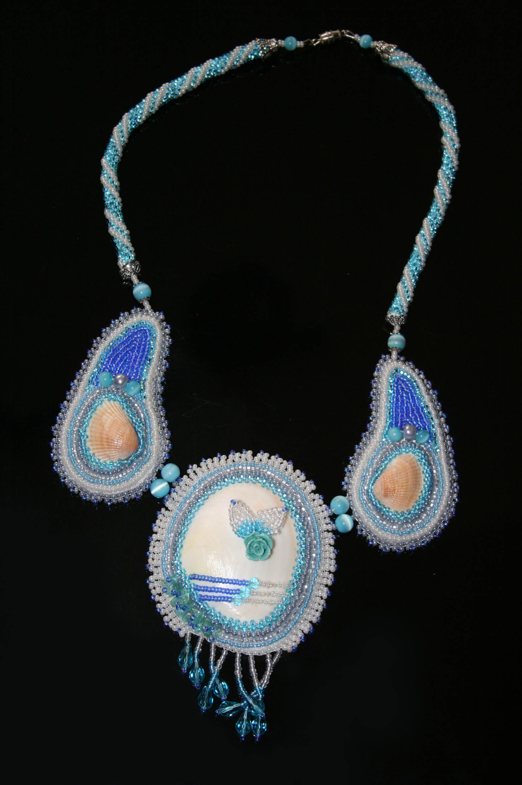 Sea Necklace - techniques: peyote and herringbone stitch, square rope, beading around cabochon, bead embroidery. Materials: seed beads 11/0, sea shells, catseye, Swarovski crystals, plastic rose and round beads