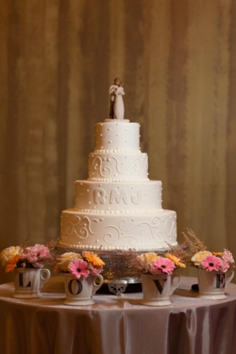 Four level white wedding cake with couple on top Renaissance Boston