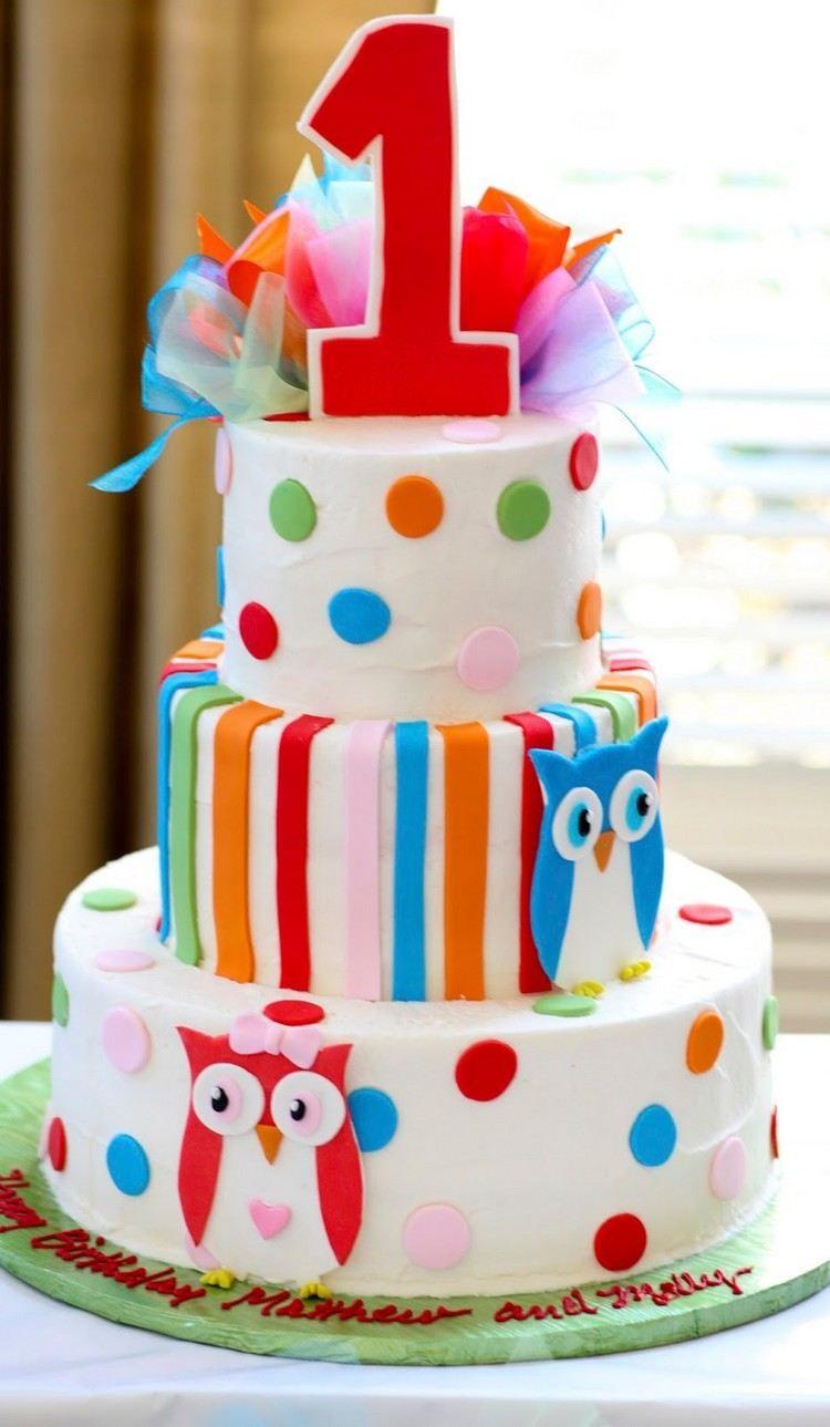 gâteau d'anniversaire thématique pour bébés jumeaux orné de hiboux et pois multicolores