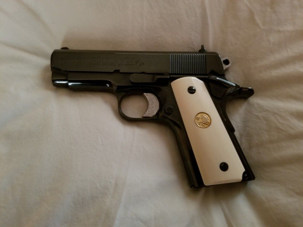 Colt Officers ACP High Polish Blue With Ivory Grips | Firearms