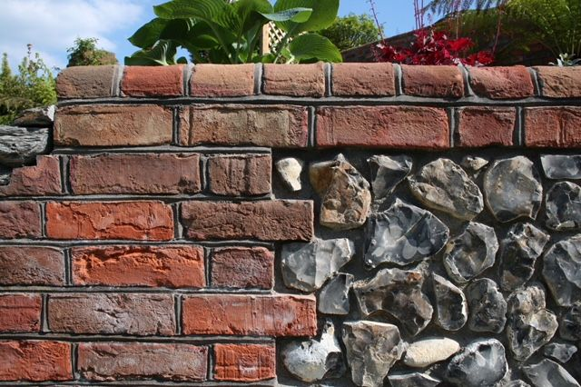 Knapped Flint used for walling in this garden design by ...