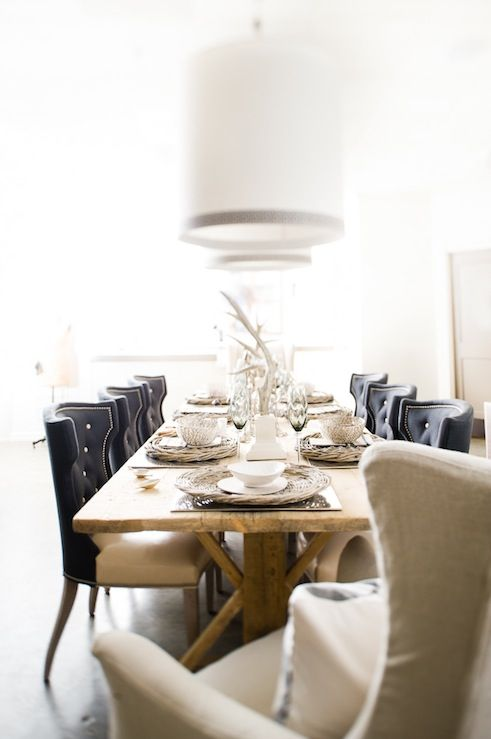 Eclectic Dining Room Design With Rustic Wood Dining Table, Black Leather  Tufted Wingback Dining Chairs