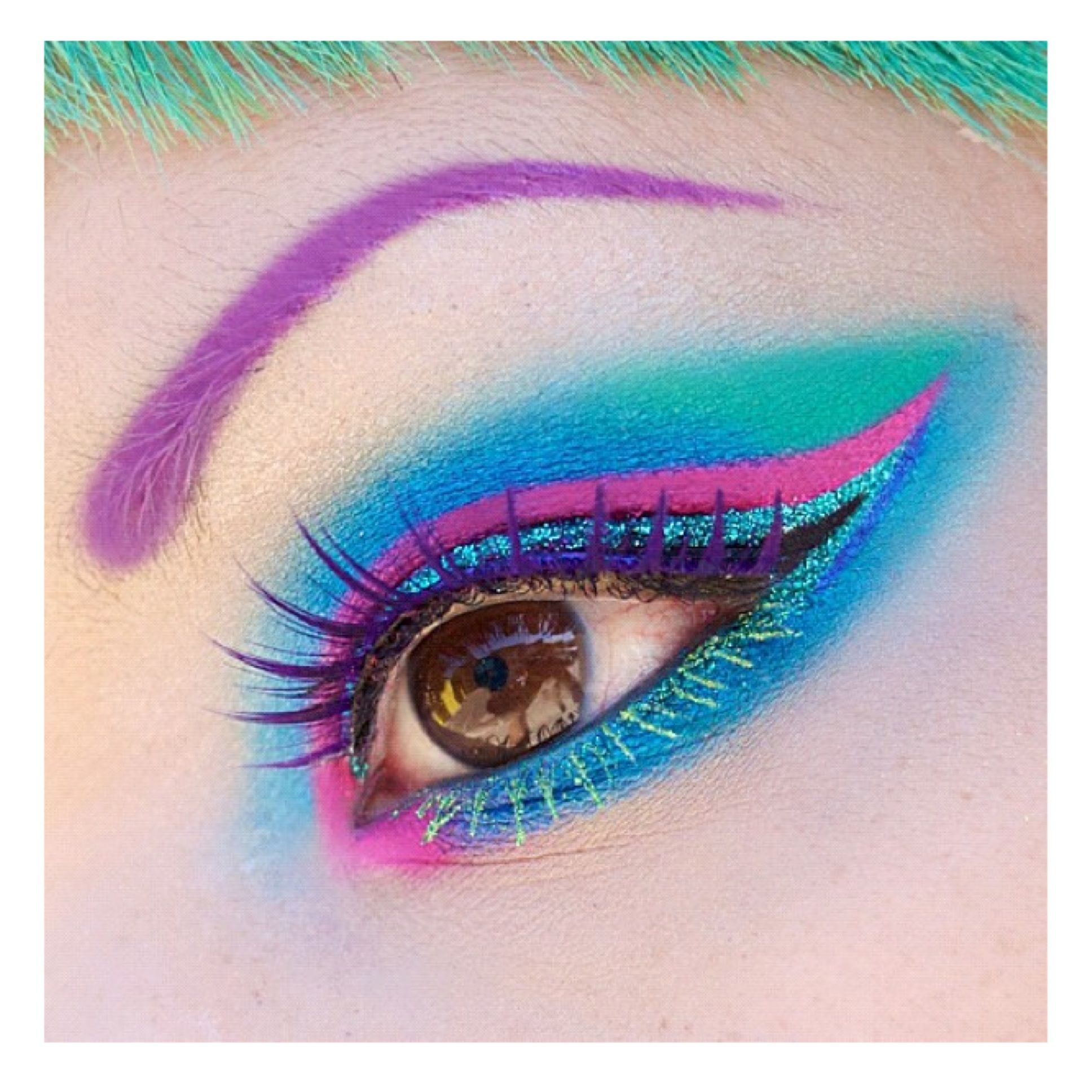 Purple brows, blue, pink eyeshadow, glitter liner, purple