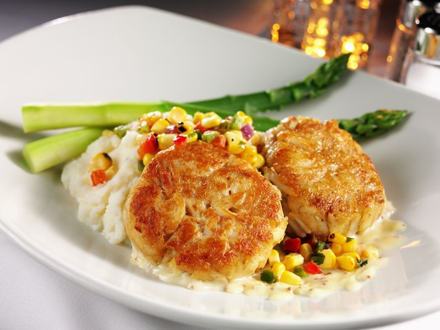 Jumbo Lump Crab Cake - Fresh crab, mustard beurre blanc, roasted corn relish, mashed potatoes, grilled asparagus - Ray's Restaurants