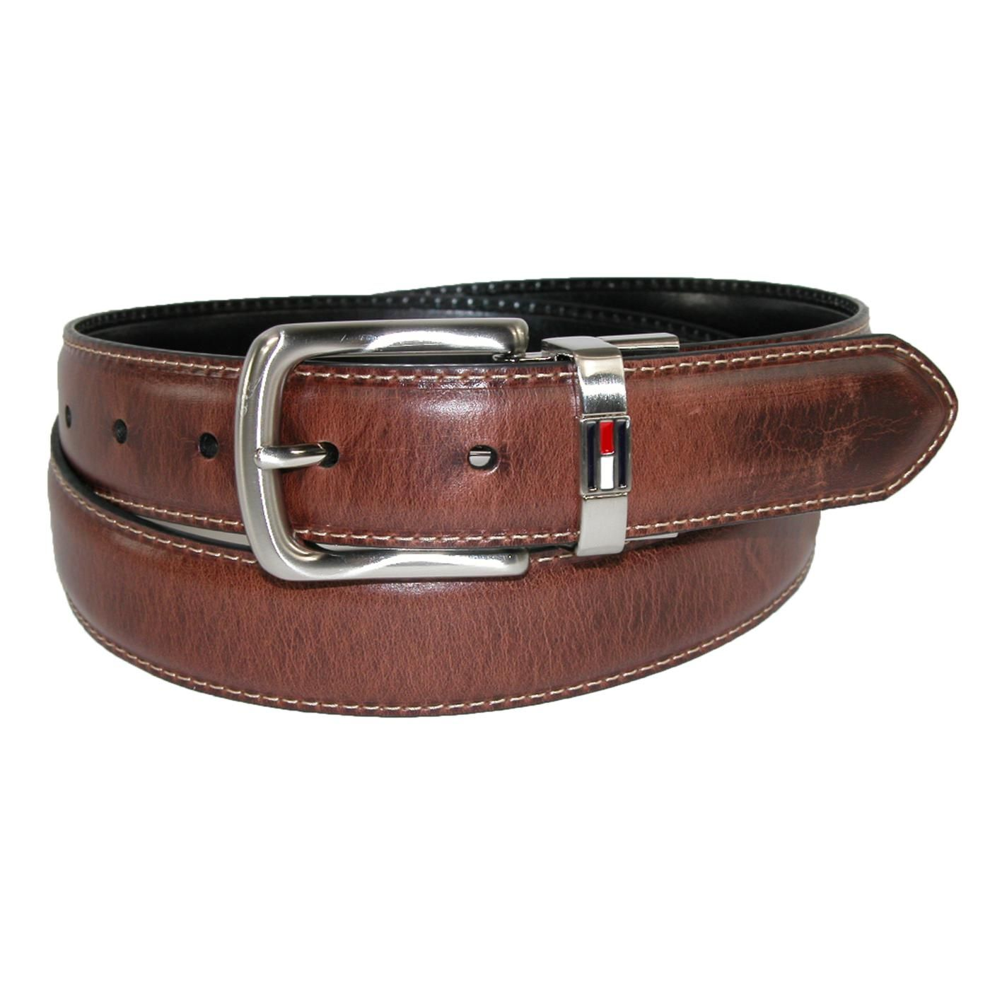 Versatile for casual or dress wear, this belt is genuine leather and 1.25 inches wide. The twist buckle is polished silver finished and the matching keeper features the Tommy Hilfiger logo. To reverse the belt, simply pull up on the buckle and twist. The brown side has a casual burnished antiqued look and the black side is smooth matte finish.