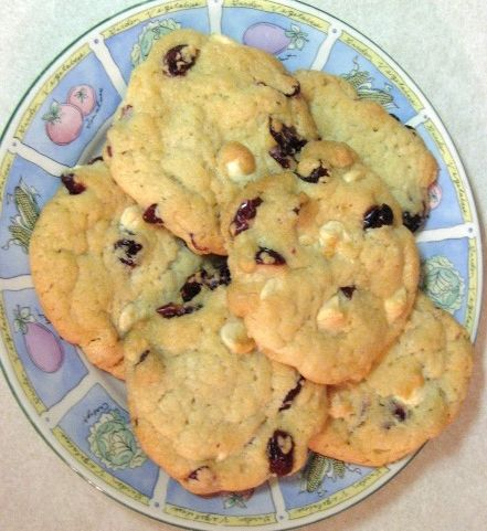 This is my favorite holiday cookie!  I only pinned this website for the pic though.  The Real deal is this - Take a package of White Chocolate Macadamia Nut cookie dough, add 1tsp orange extract and 1/2 cup craisins. Bake as the package says!!! YUMMY