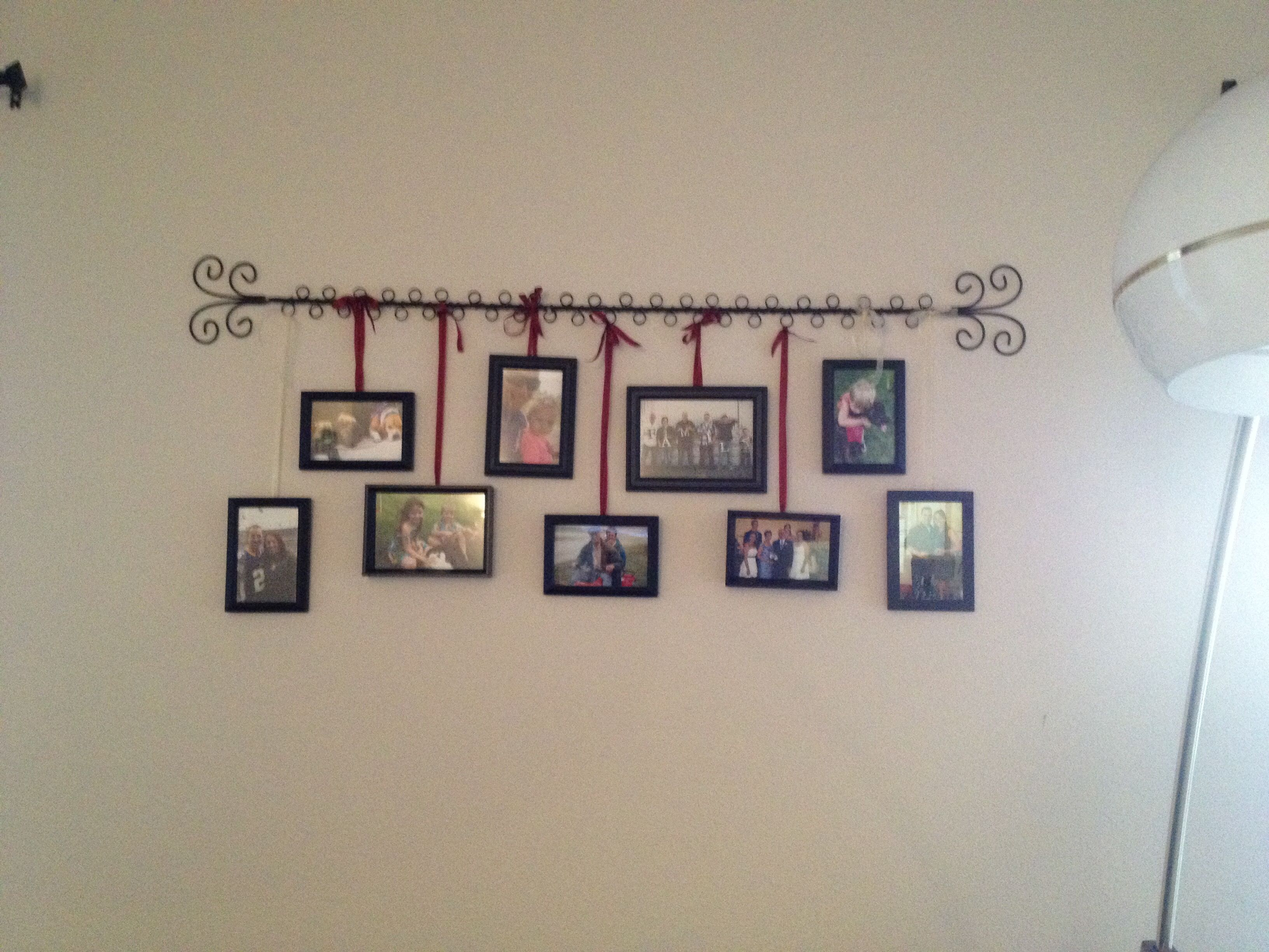 Picture Wire Hanger From Pier One Imports With Random Frames Hung By Ribbon Needed Something To Take Up E Can Always Add More Pictures Below