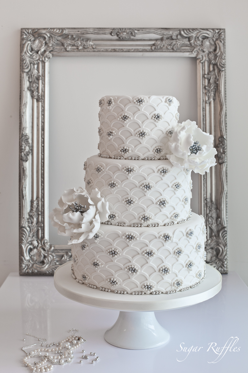 Elegant silver scalloped wedding cake by sugar ruffles weddingcake