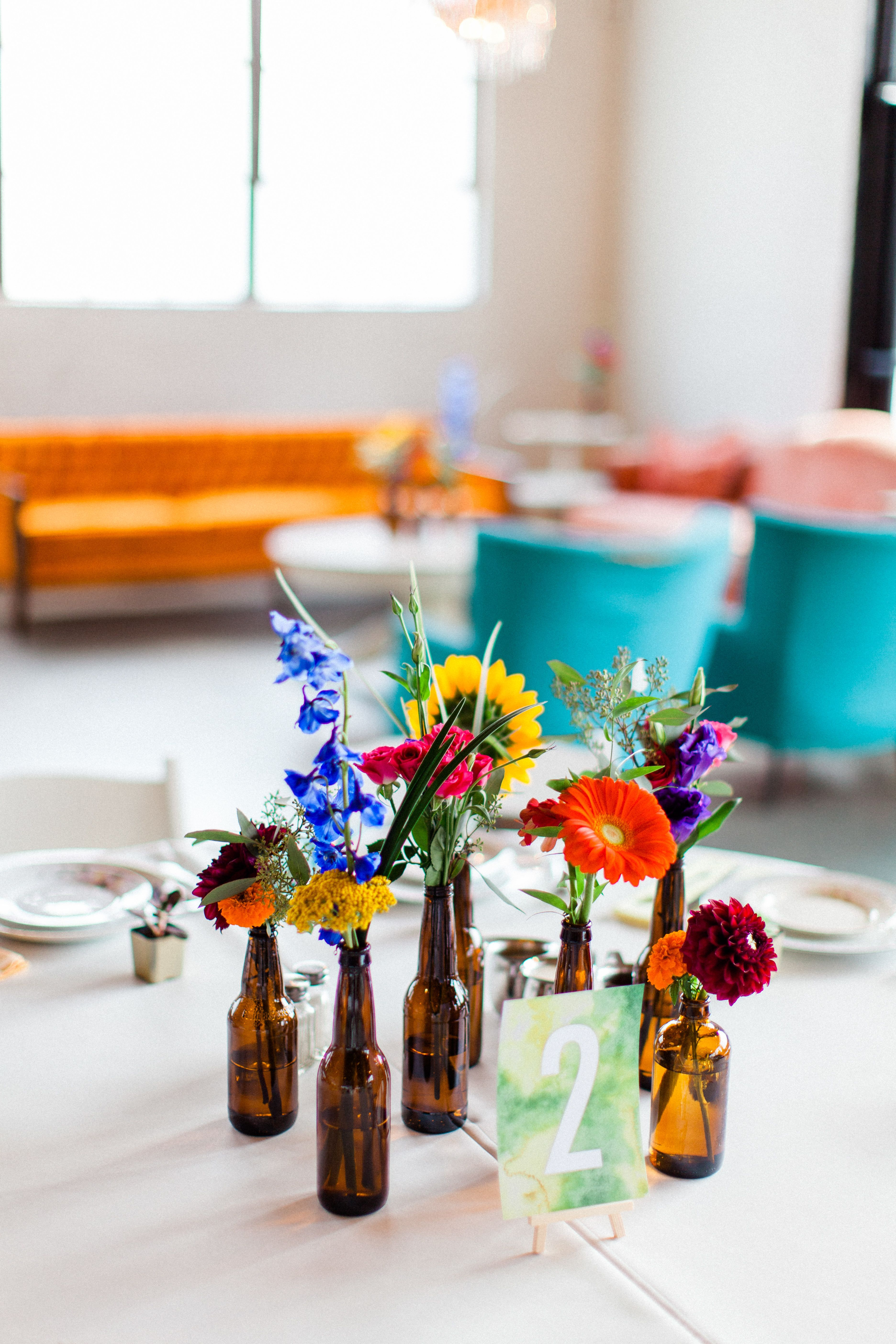DIY Bottle Centerpieces with Sunflowers, Dahlias and