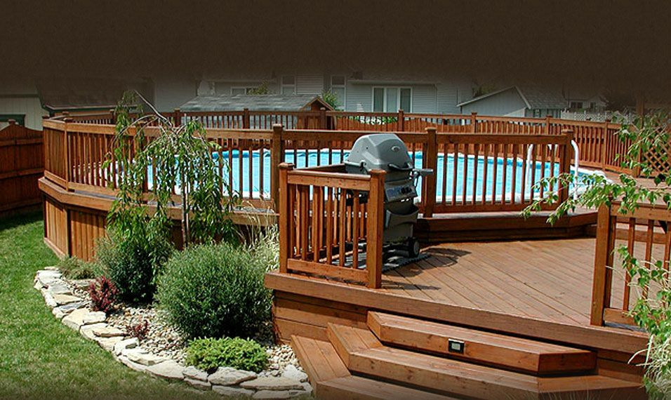 round above ground pool floating with wooden decks
