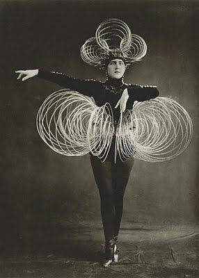 Triadic Ballet by Oscar Schlemmer (German designer and choreographer, related with the Bauhaus). The ballet became the most widely performed avant-garde artistic dance. The costumes are geometric shapes (like living sculptures).