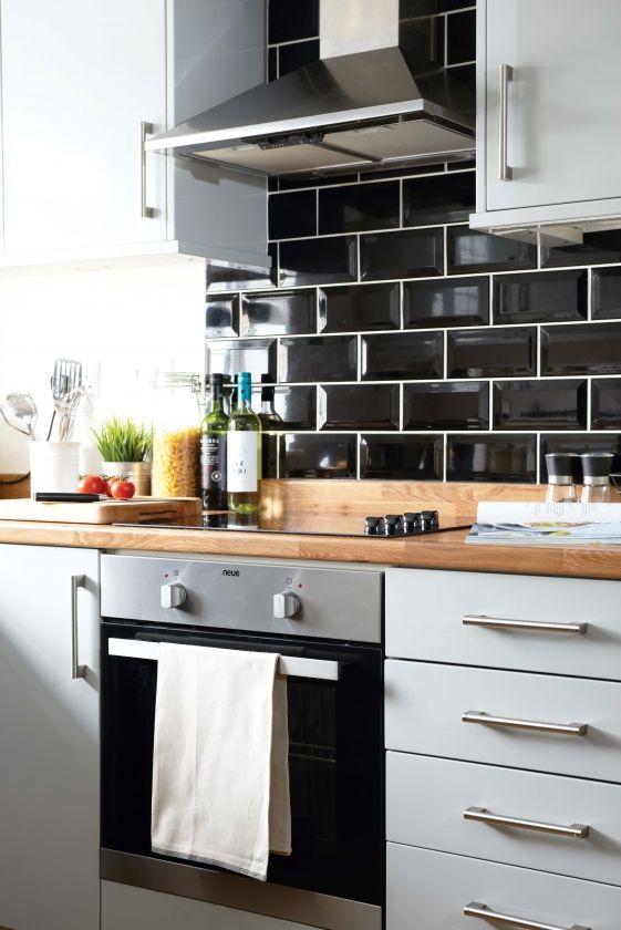 Kitchen Clean Modern Cooker Hood Storage Cabinetry Drawers Oven Tiles Black Tiled Splashback Wooden Worktop