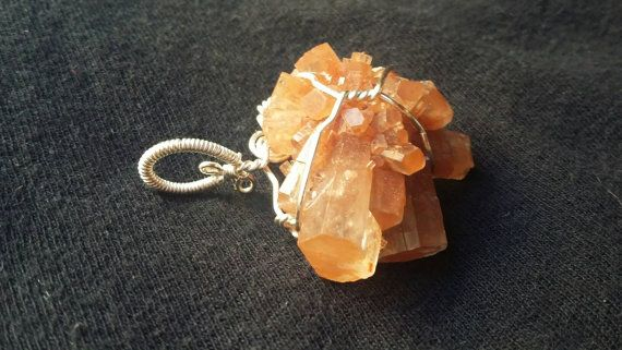 Check out this item in my Etsy shop https://www.etsy.com/listing/488735094/aragonite-wire-wrapped-pendant