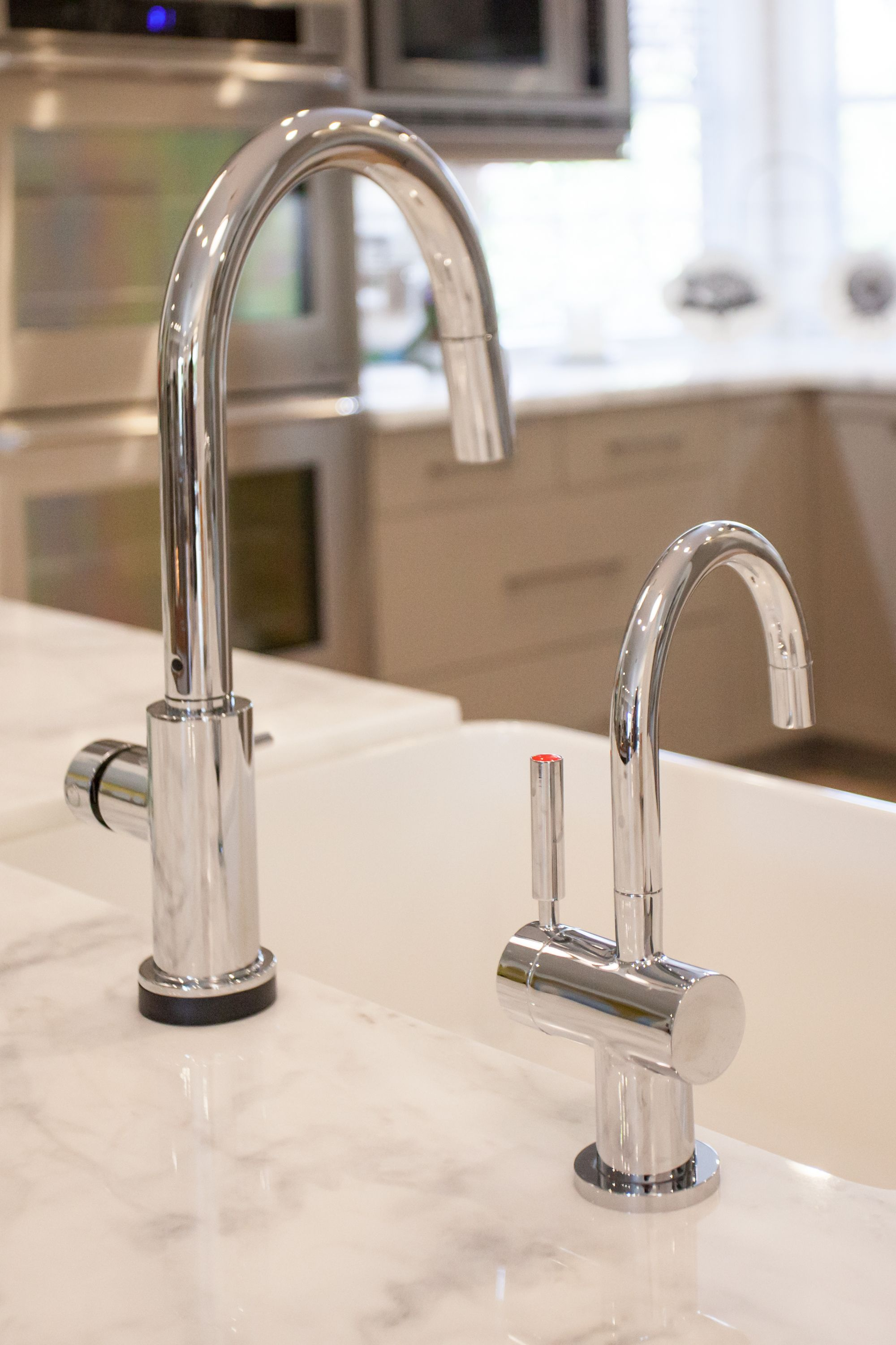 The Delta Trinsic Smart Touch Faucet along side the Insinkerator ...