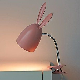 A Clamp On Light With Bunny Ears And A Fancy Ass Lamp That Looks