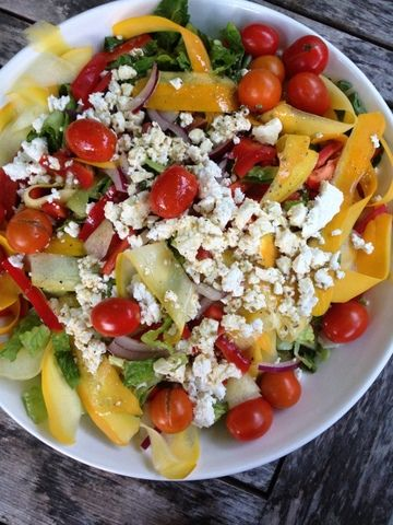 Romaine, red onion, raw summer squash ribbons, various cherry tomatoes, feta, red bell pepper, oregano and red wine vinegar dressing.