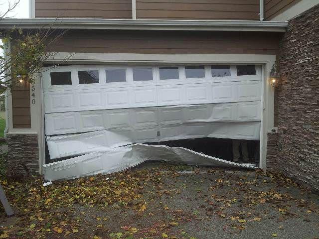 What To Do When Your Garage Door Is Damaged Garage Doors Commercial Garage Doors Garage Door Security