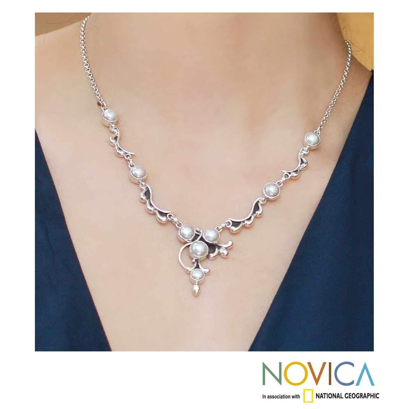 Accentuating white pearls, sterling silver is a shining complement in this necklace from India. The gemstones are ravishing in a necklace designed by Neeru Goel.